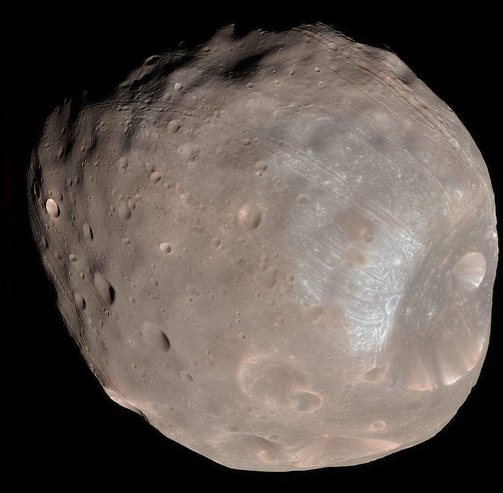 Mars' unusual moons may have been created by collision with Pluto-sized object
