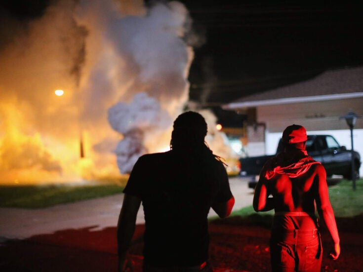 Why are US police firing tear gas and rubber bullets in Ferguson, Missouri?