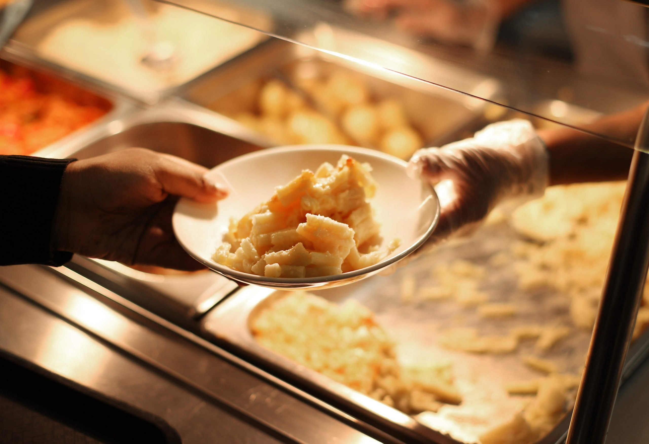 Want to end cruel lunch isolation policies? Make school meals free for all