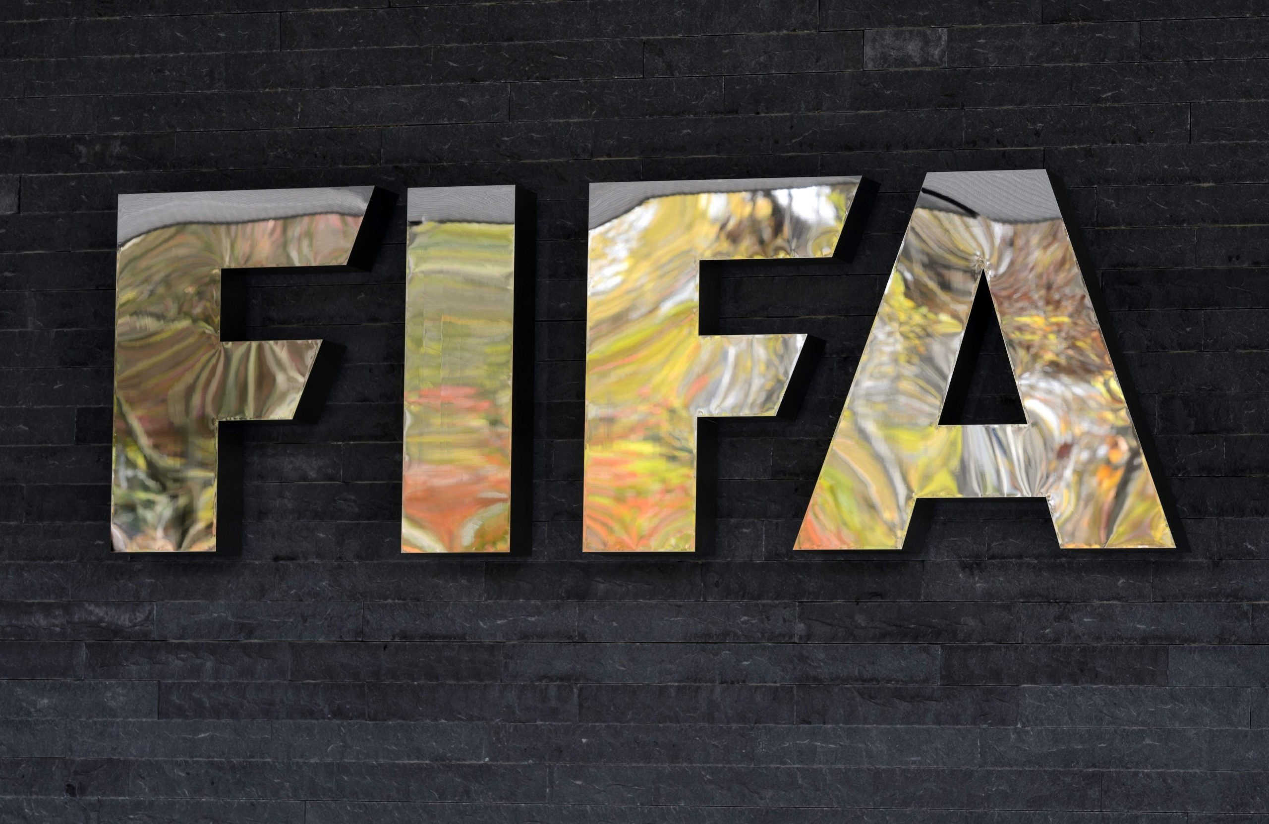 Exit one smooth bald Swiss career administrator at Fifa - and enter another