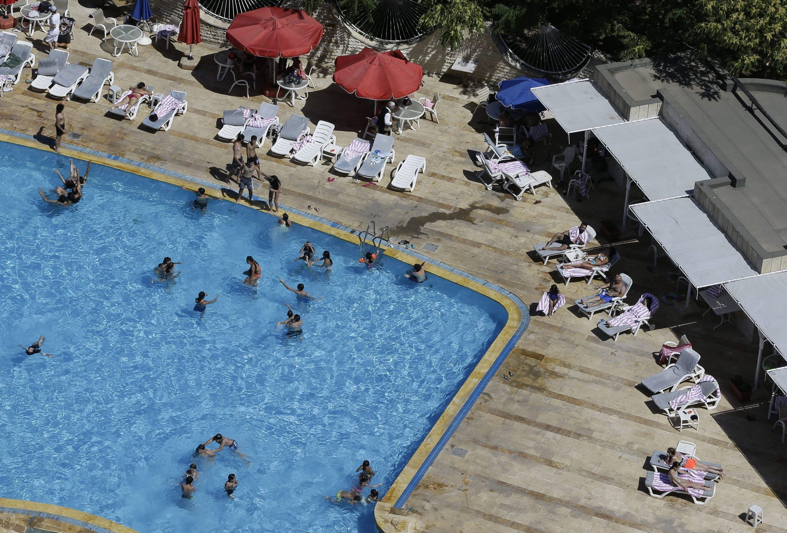 Swimming in Aleppo: why people still head to the pool in war zones