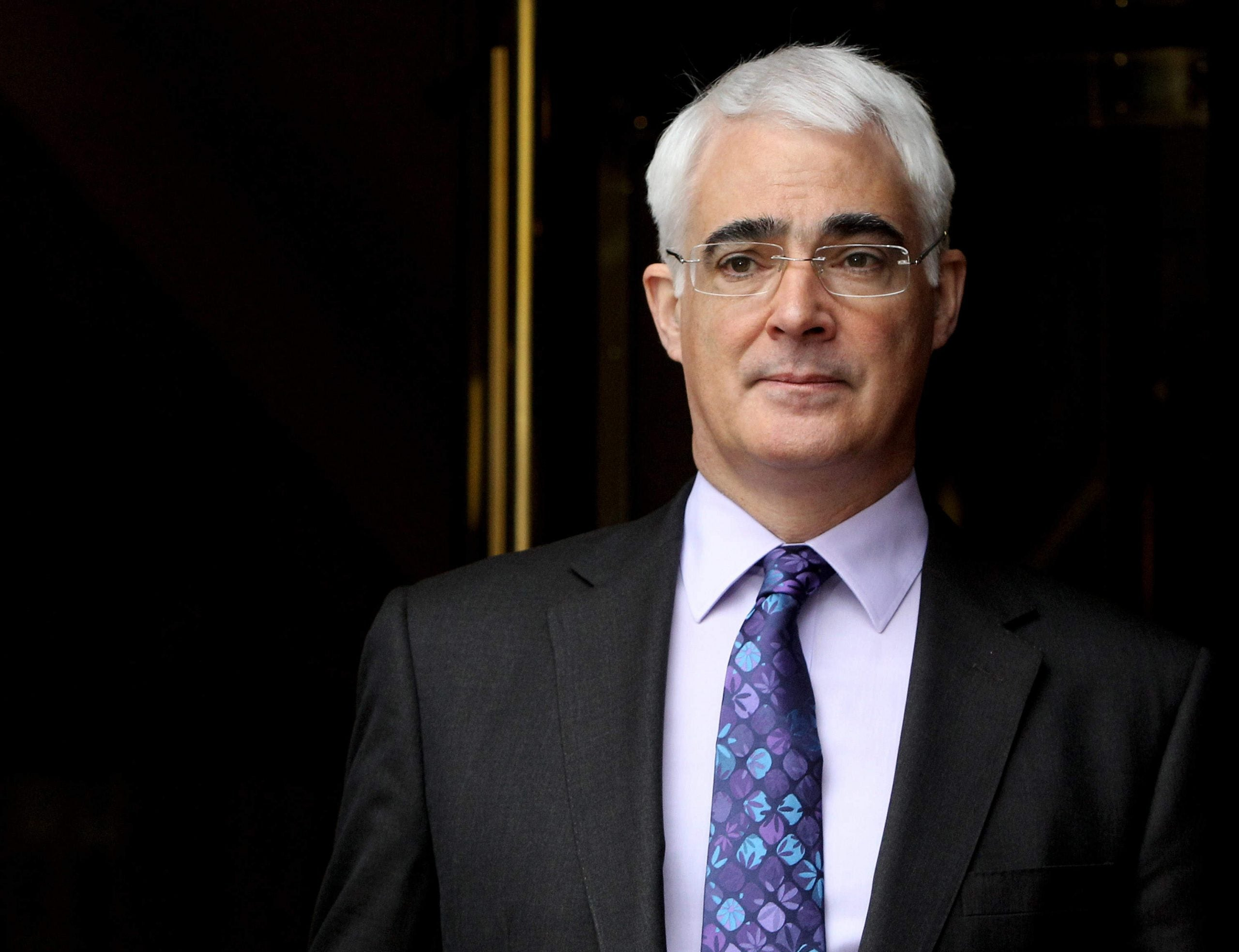 The man at our table was a beggar, and he was asking Alistair Darling for change