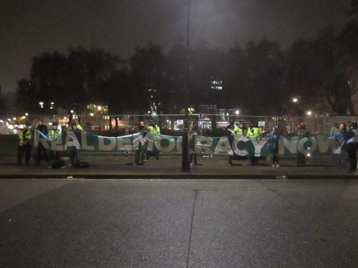 Why are Occupy Democracy protesters staging another occupation in London?