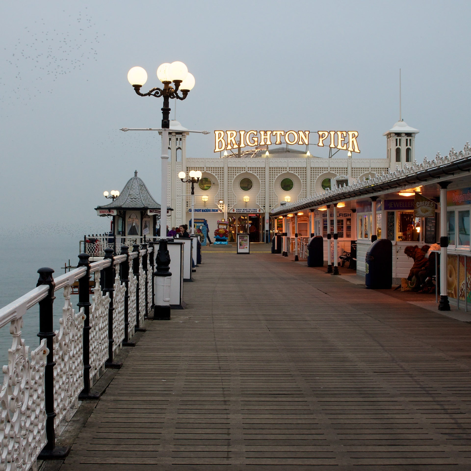 I was only meant to stay for a night, but here I still am, in the gloom and glamour of Brighton
