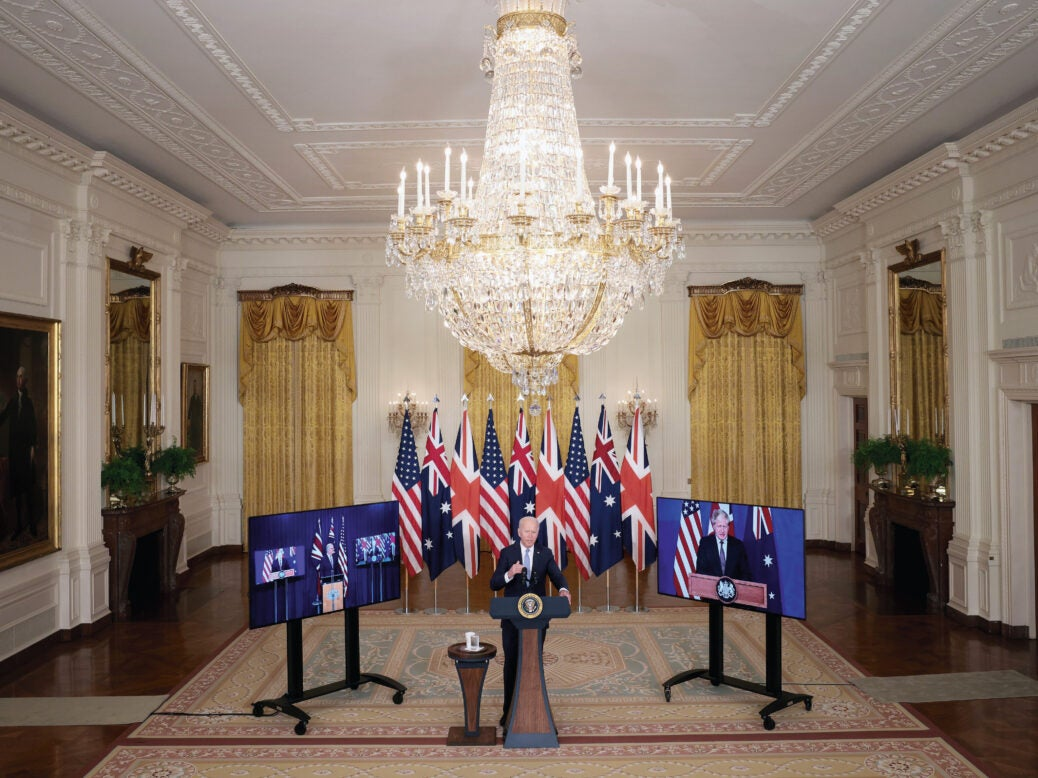 Triple lock: Joe Biden announces the Aukus alliance, flanked by screens showing Scott Morrison and Boris Johnson, 15 September