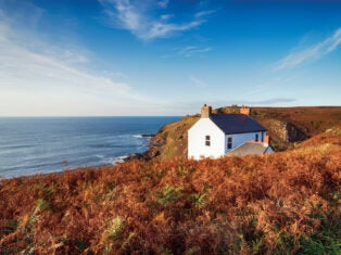 A white cottage on the cliffs at Cape Cornwall