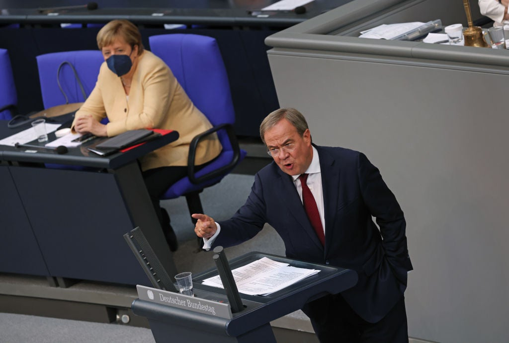 Angela Merkel looks on as Armin Laschet, chancellor candidate of the Christian Democrats (CDU/CSU), speaks at the final session of the Bundestag before federal parliamentary elections take place on 26 September, 2021.