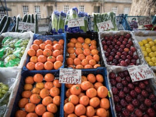 Fruit and vegetables are displayed outside Bath Bus Station Fruiterers stall on January 18, 2017 in Bath, England