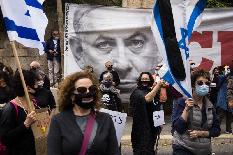 Israelis demonstrate on the first day on Netanyahu's trial